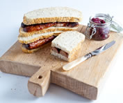 Sausage Sandwiches with Red Onion and Rosemary Relish